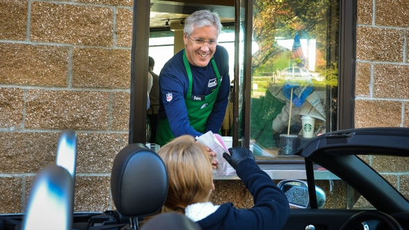 Coach Pete Carroll surprises a drive-thru customer.