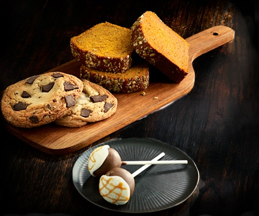 Image of Starbucks food: cookies, pumpkin loaf, and cake pops for treat receipt promotion