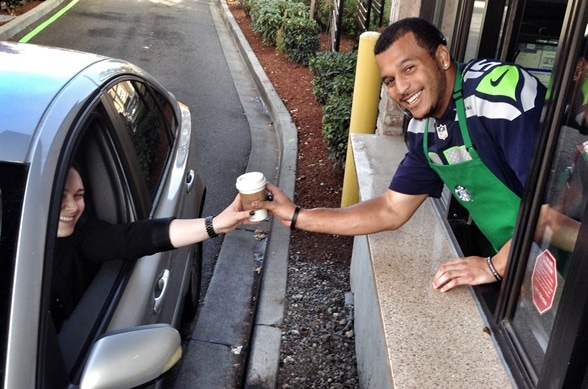 Jermaine Kearse hands out beverages at 1st & Walker in Seattle.