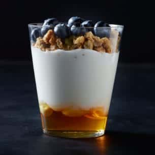 fat Dannon® Greek yogurt is layered with fresh, seasonal blueberries ...