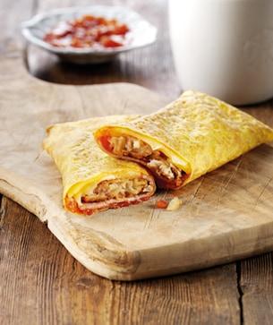 An egg crepe filled with bacon, tomato chutney, hash brown & Jarlsberg ...