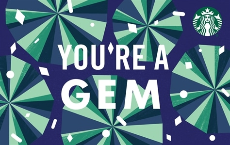 """This card is a top down view of diamonds against a dark purple background, causing the gems to look green and blue. Across the middle is the phrase """"You're a Gem"""" written in large white letters"""