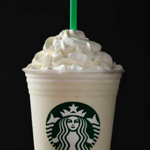 A Smooth Blend Of White Chocolate Sauce Milk And Ice Topped With Whipped Cream For Flavor That Wows
